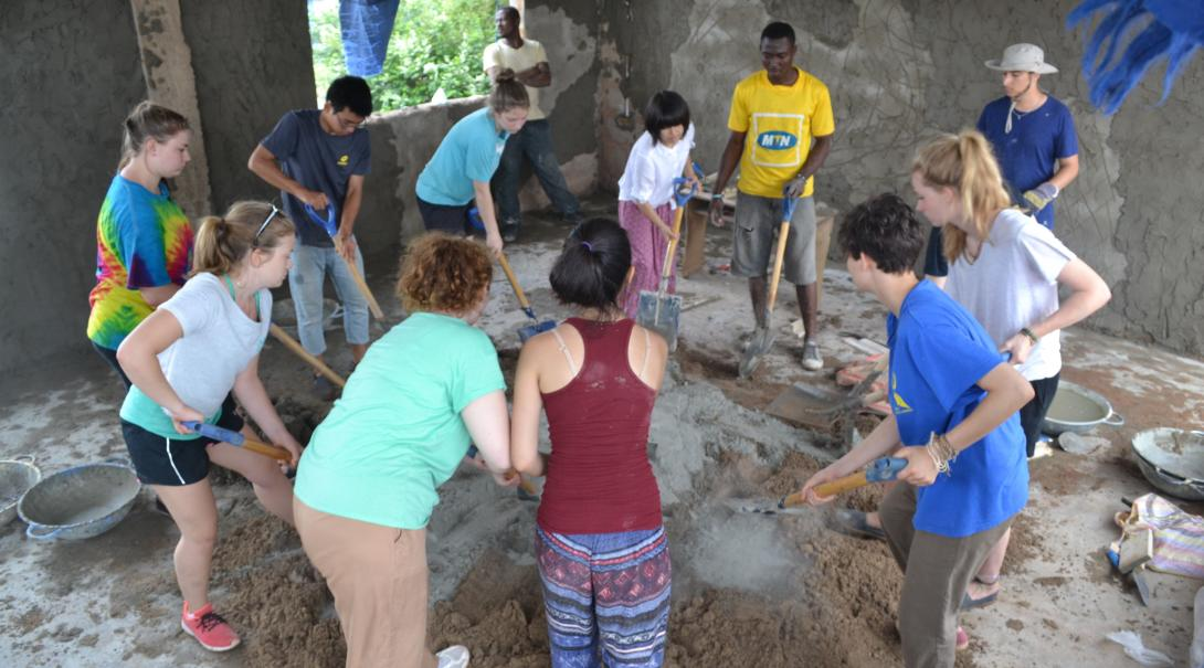 A group of Projects Abroad teaching volunteers participate in renovation work to improve a school in Ghana.